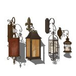 4 different types of wrought iron candle lanterns.