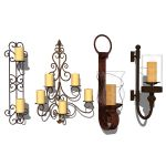4 different wrought iron wall candle holders.