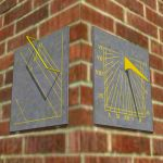 A set of three vertical sundials on slate backs wi...