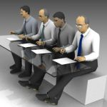 Four seated office workers