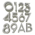 Set of stainless steel house numbers, and two lett...