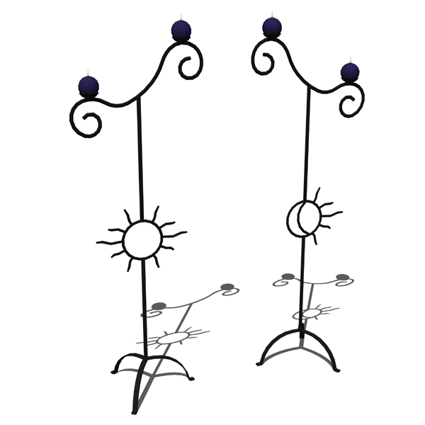 Wrought iron sun and moon standing candle holders.....